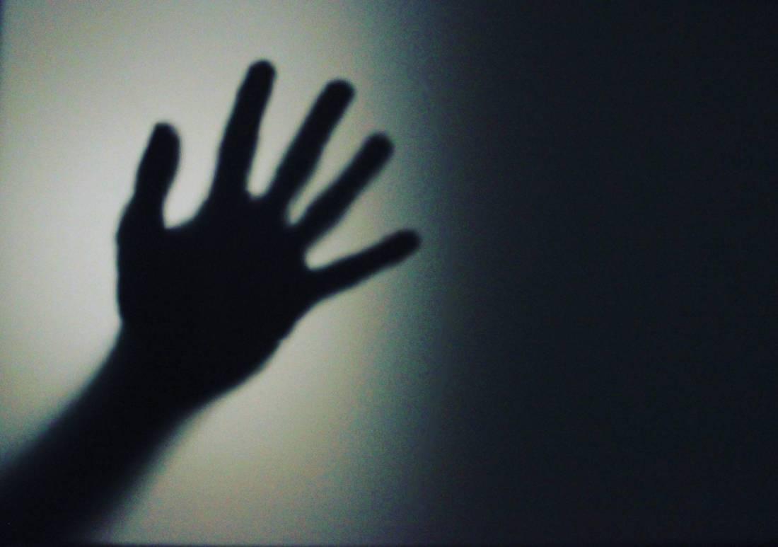 silhouette person s hand